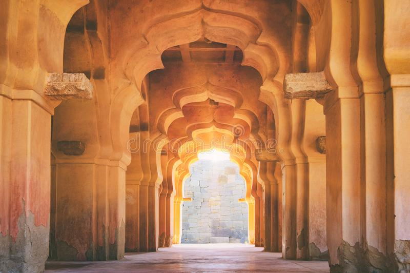 Old ruined arch of Lotus Mahal in Hampi, India royalty free stock image