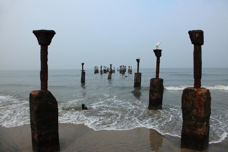 Old ruined sea piers stock images