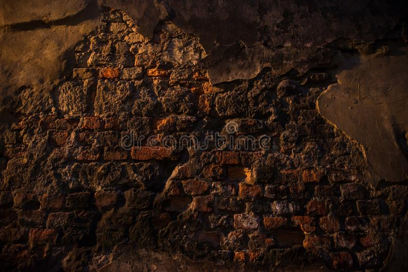 Old ruined wall made of different bricks. Texture. royalty free stock photo