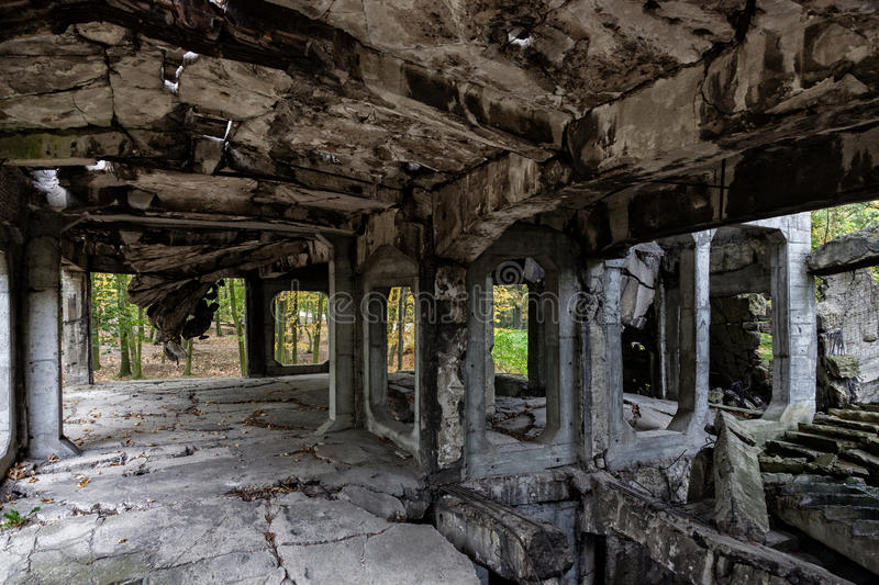 Old ruins interior. Image of the interior old destroyed military barracks after war stock photography
