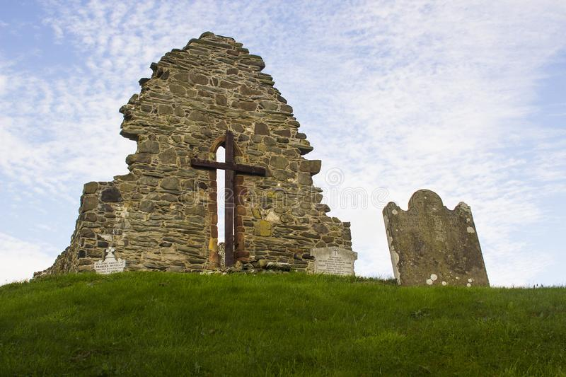 The old ruins of the original St Aidan`s Church at Bellerina in County Londonderry in Northern Ireland. The church is located near an ancient Holy Well stock image