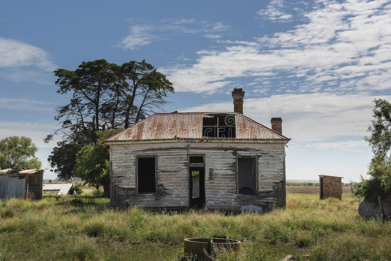 An old run down abandoned farm house. A old house that was once someones pride and joy, now withering away royalty free stock photos