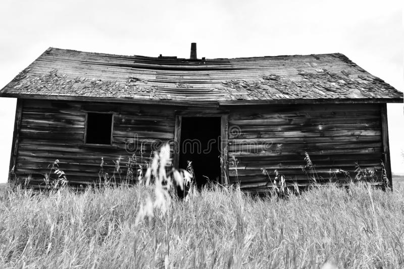 Old Run Down Buildings. A black and white image of old run down and abandoned farm buildings stock images