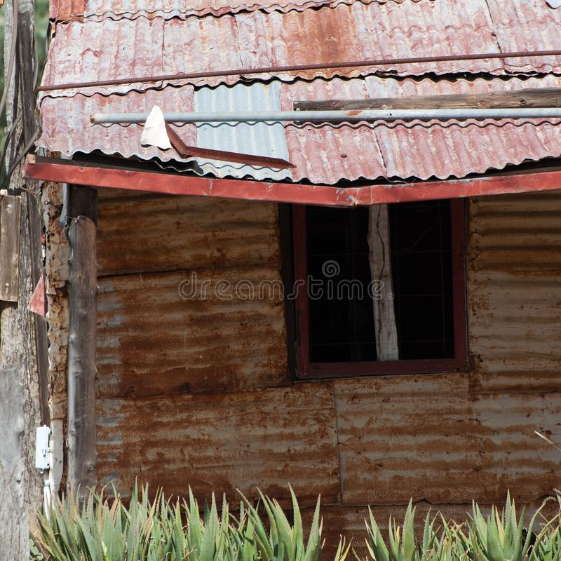 Old run down miners hut made out of metal corrugated sheets stock photo