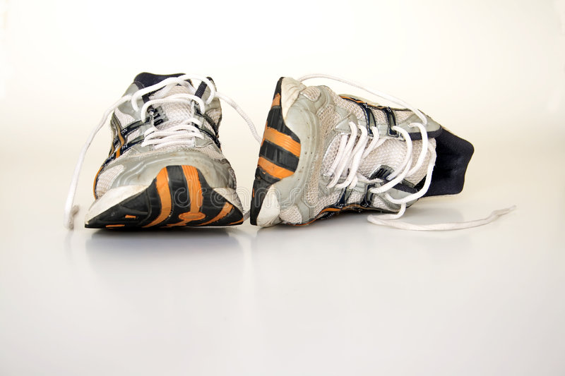 Old running shoes. On a white background royalty free stock photo
