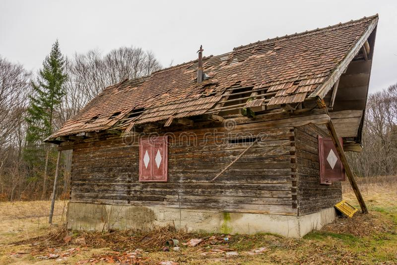 Old rural abandoned wooden collapsing house stock photo