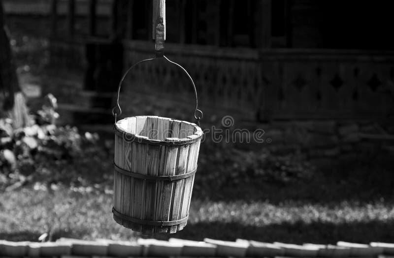 Old rural bucket well stock photo