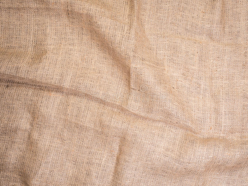 Old rural burlap vintage background, photo top view. Hessian, sacking texture, background for your design. Copy space for your message stock image