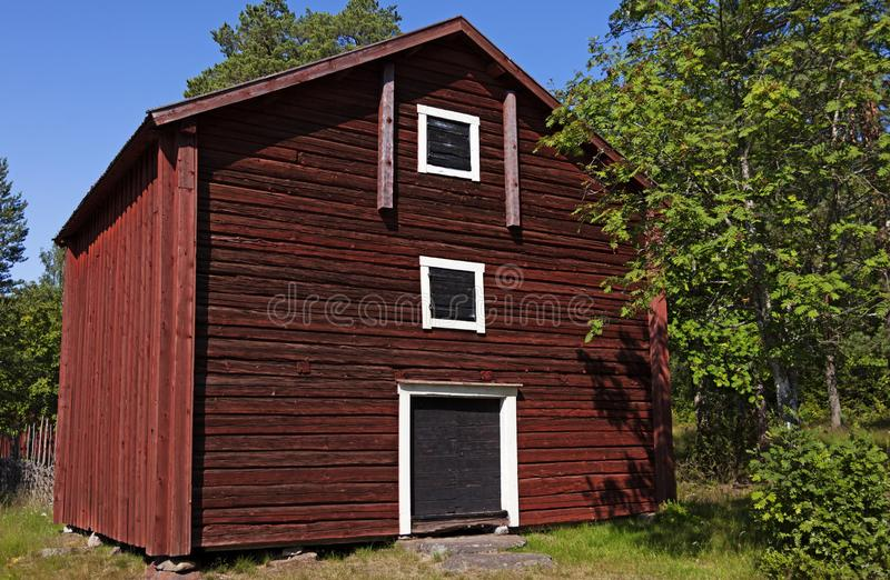 Old rural house from Norrland in red, white and black wood stock images