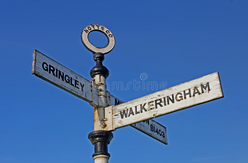 Old rural road sign, with postbox royalty free stock photography