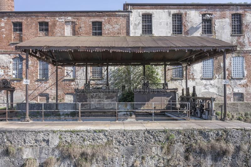 Old rusrt canopy on millwork of lock on Naviglio canal, Milan, Italy royalty free stock photo