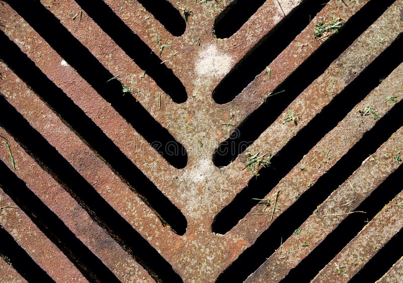 Old rusrty sewer manhole drain, texture royalty free stock photo
