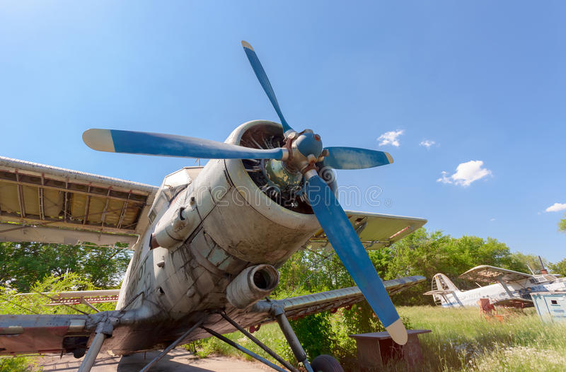Old russian aircraft An-2 at an abandoned aerodrome royalty free stock photography