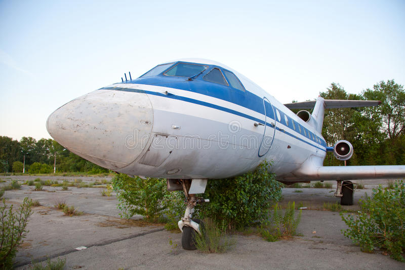 Old russian airplane is on the disused airfield. Old russian airplane YAK-40 is on the disused airfield royalty free stock photography