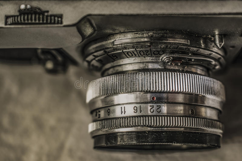 Old Russian analog film cameras with manual controls. Close up view from above of old Russian analog film camera on dirty canvas with vintage look. On the camera royalty free stock image