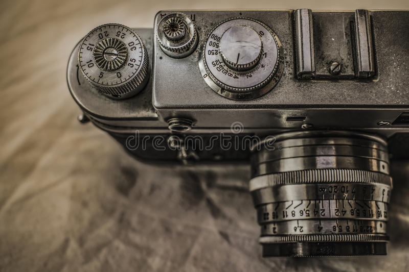 Old Russian analog film cameras with manual controls. Close up view from above of old Russian analog film camera with vintage look. On the camera, there can be royalty free stock photos