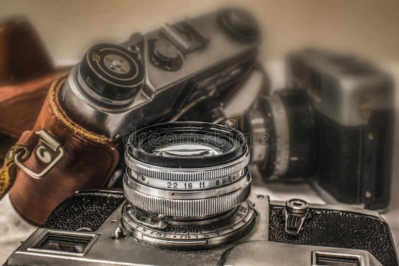 Old Russian analog film cameras with manual controls. Close up view of old Russian analog film camera with vintage look. On the camera, there can be seen royalty free stock image