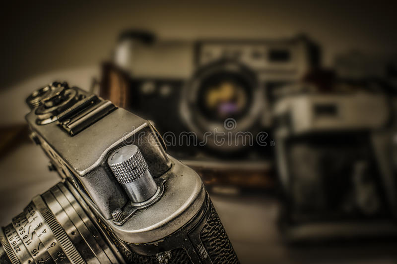 Old Russian analog film cameras with manual controls. Close up view of old Russian analog film camera with vintage look. On the camera, there can be seen film royalty free stock photo