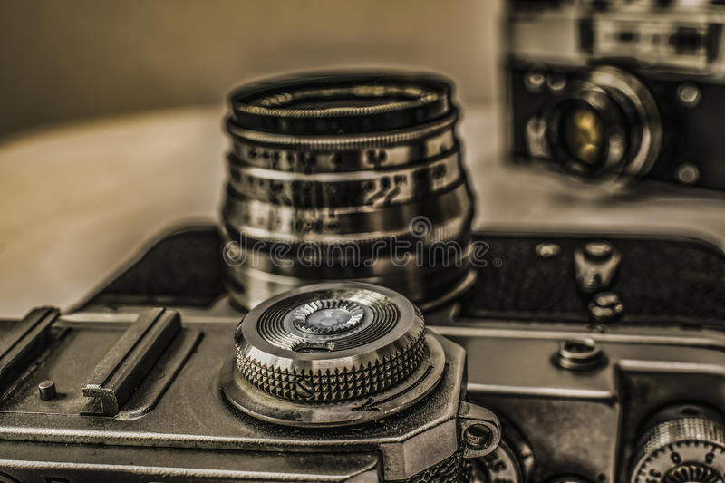 Old Russian analog film cameras with manual controls. Close up view of old Russian analog film camera with vintage look. On the camera, there can be seen film royalty free stock image
