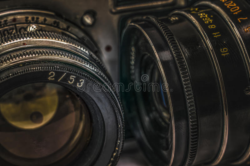 Old Russian analog film cameras with manual controls. Close up view of two lenses on old Russian analog film cameras with vintage look. There can be seen stock photo