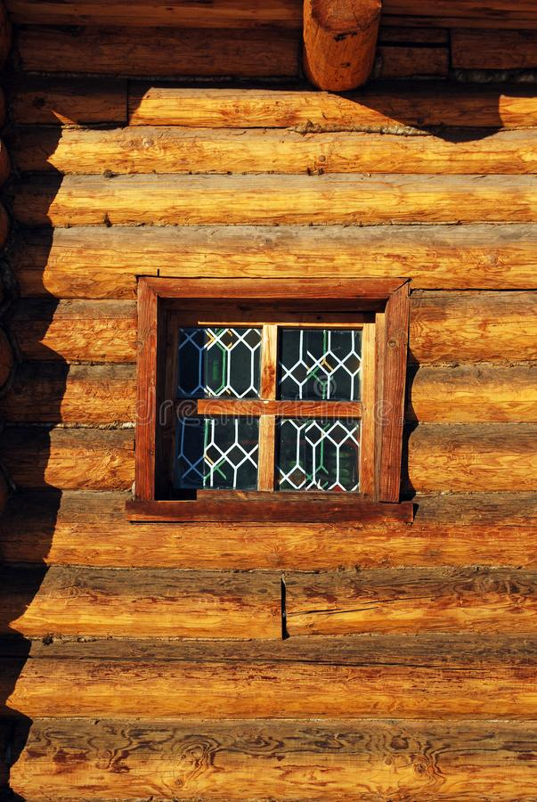 Old Russian architecture. A wall from a tree felling with a small window. Construction. Russia stock photo