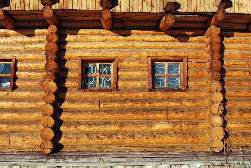 Old Russian architecture. A wall from a tree felling with a small window. Construction. Russia stock photos
