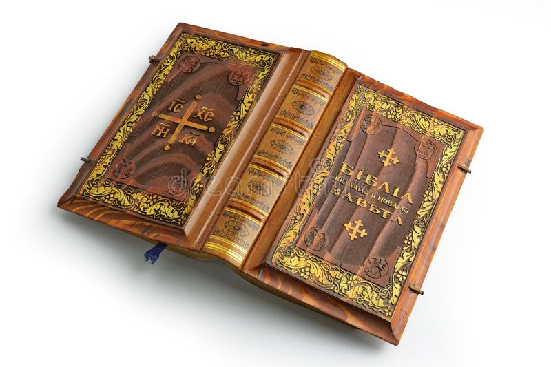 Old Russian bible with wooden cover lay down to the table opened on the half stock photography