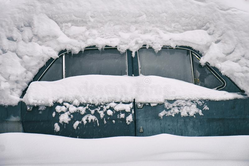 Old russian soviet car buried under the snow stock photos