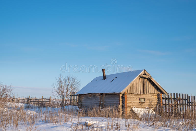 Old russian steam bath in winter royalty free stock photography