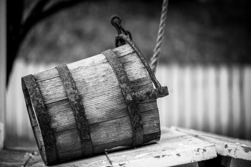 Old water bucket sitting on water well in Williamsburg Virginia stock photos