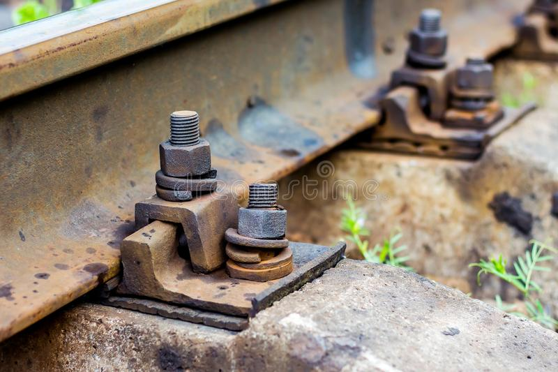 Old rust bolts for mounting rails on railroad track. Bolt conne. Ction of parts royalty free stock photo