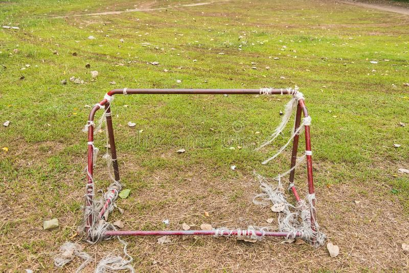 Old rust football goal abandoned soccer goal field located on the ground. Play, game, nature, rusty, grass, sport, playground, village, landscape, leisure stock images