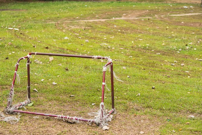 Old rust football goal abandoned soccer goal field located on the ground. Play, game, nature, rusty, grass, sport, playground, village, landscape, leisure royalty free stock photo