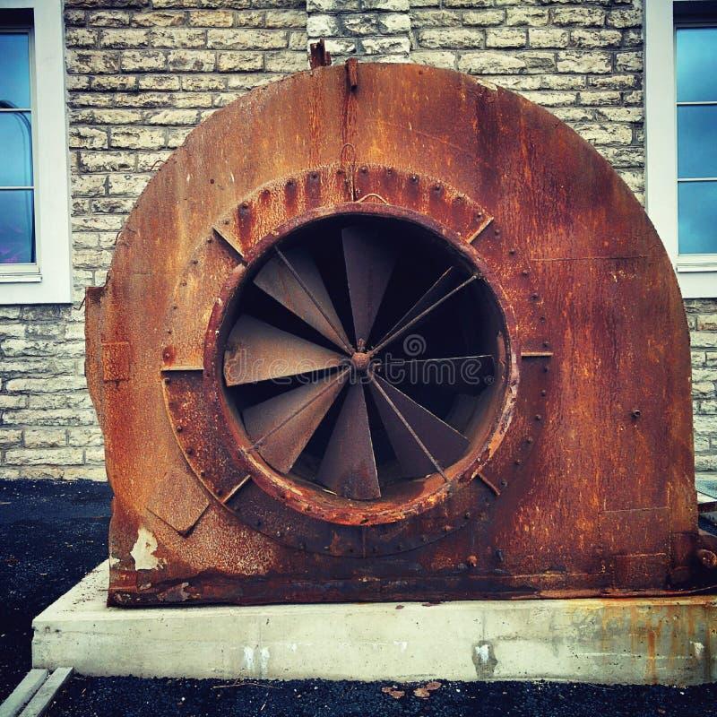Old rust turbine. In Tallinn near sea port royalty free stock photography