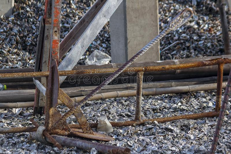 Old anchor iron on the floor. Old rusted anchor iron was placed on the floor after being idle stock photo