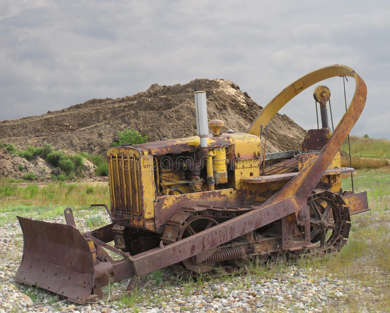 Old rusted bulldozer tractor with blade