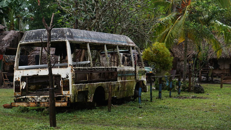 Old Rusted Bus In Tropical Setting stock images