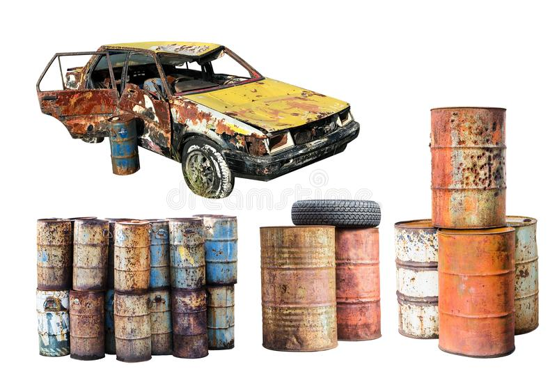 Old rusted car and destroyed rust metal oil barrel isolated on w stock photography