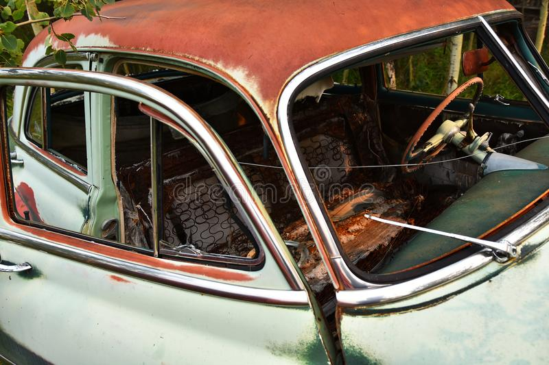Old Rusted Car Wreckage. An abstracted image of the rusted wreckage of an old abandoned car royalty free stock photography