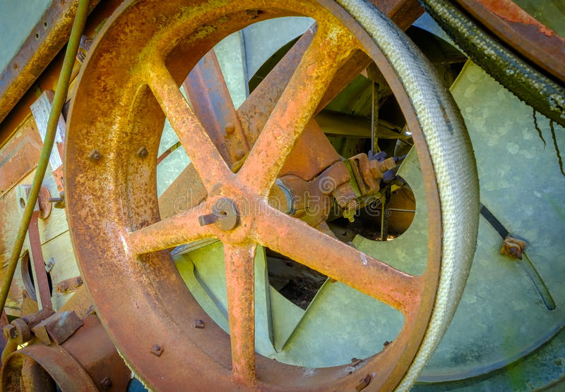 Old Rusted Farm Equipment, Palouse Washington. A closeup view of the textures of a rusted wheel on vintage colorful farm equipment, from an abstract perspective royalty free stock images
