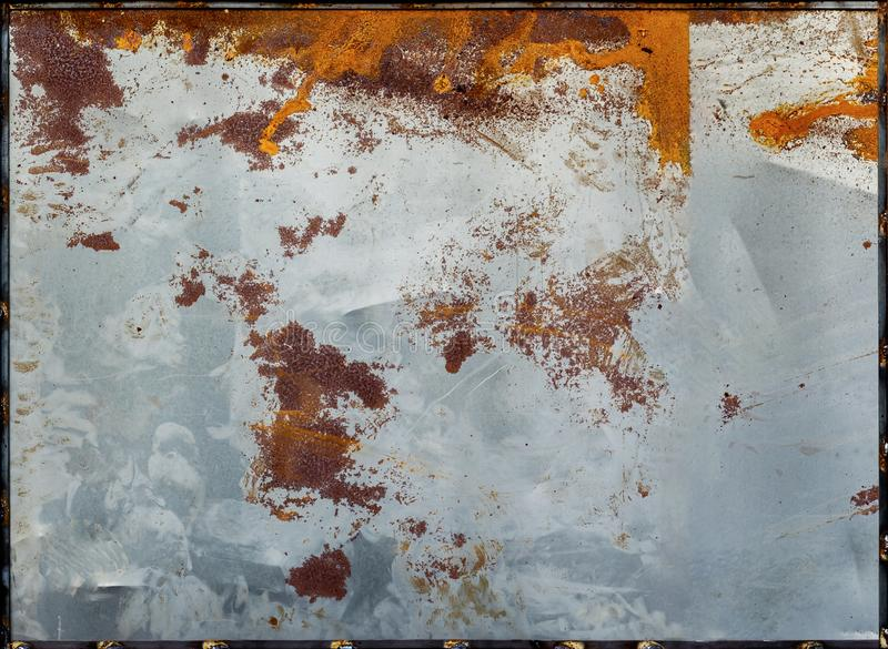 Old rusted galvanized metal sheet. Rusty surface caused by oxidation iron with orange and brown cracked color. For design work te. Xture and background royalty free stock photos