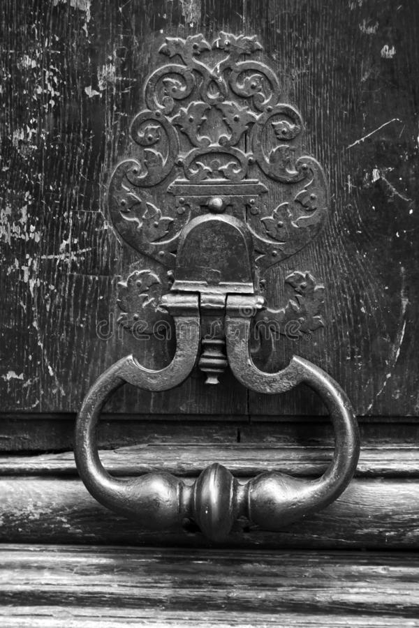 Old rusted knocker on wooden door in Paris, France stock image