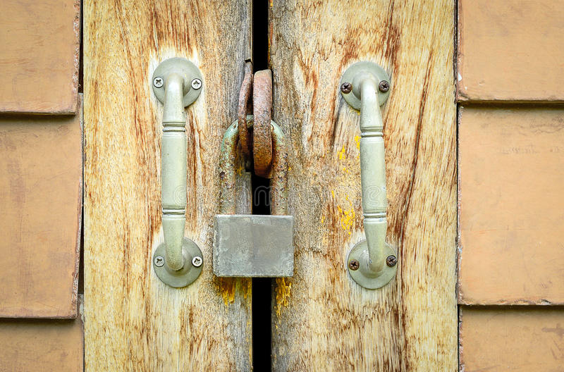 Old rusted lock on a wooden door royalty free stock image