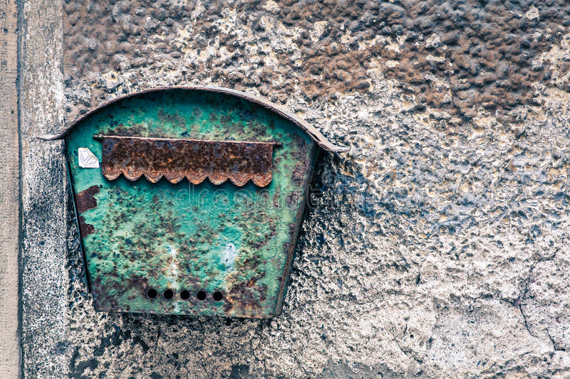 Old rusted mailbox hanging on old wall royalty free stock photography