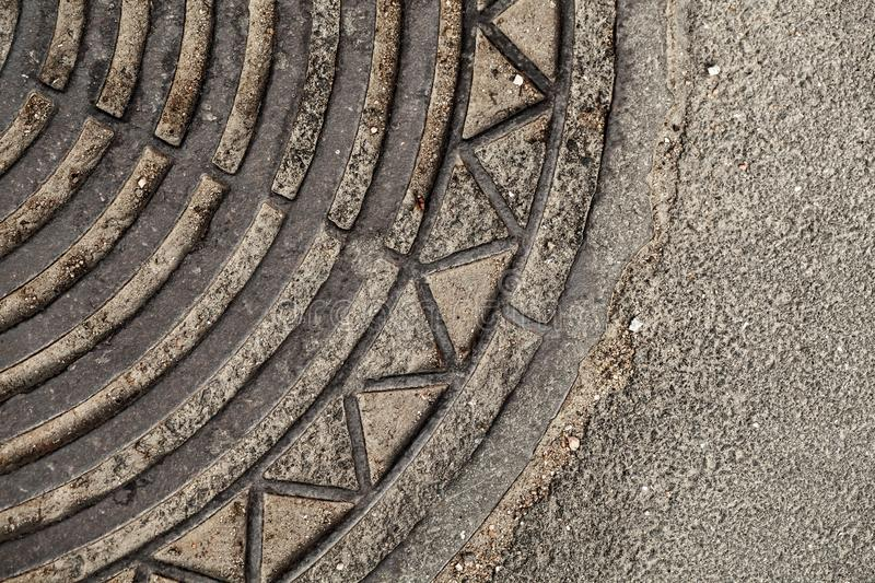 Old rusted sewer manhole close-up. Abstract fragment royalty free stock images