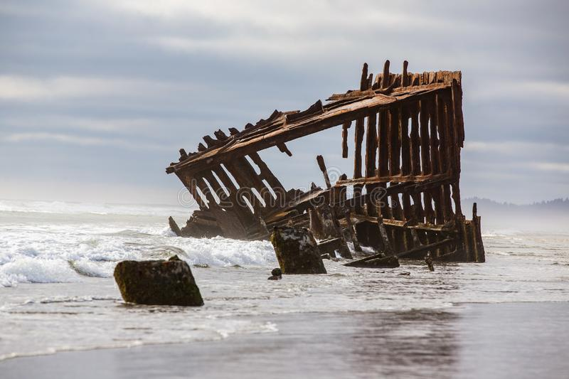 Old rusted shipwreck at the Oregon coast. royalty free stock photo