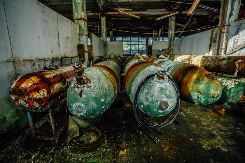 Old rusted submarine torpedoes in abandoned torpedo factory.  stock photos