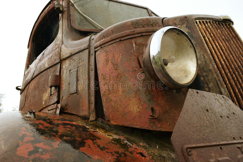 Old rusted truck in the rainb vintage stock photos