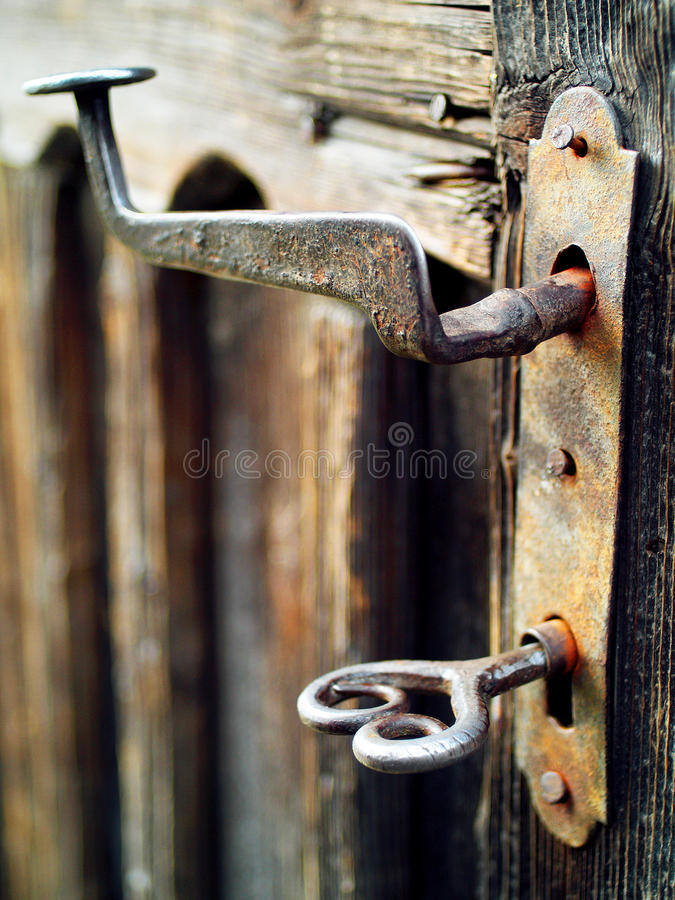 Old and Rusted Vintage Door Handle and Beautiful Key stock photos