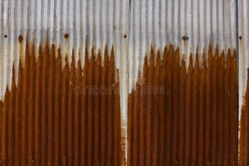Old galvanized sheet is rusty. stock photos